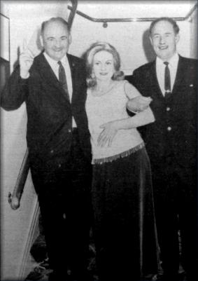 Pat Walsh (left) and Eric D. Butler (right) escort Mrs. Butler to dinner (1968)